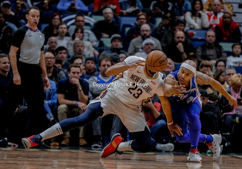 Dec 10, 2017; New Orleans, LA, USA; New Orleans Pelicans forward Anthony Davis (23) and Philadelphia 76ers guard Jerryd Bayless (0) scramble for a loose ball during the second half at the Smoothie King Center. The Pelicans defeated the 76ers 131-124. Mandatory Credit: Derick E. Hingle-USA TODAY Sports