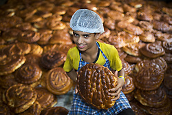 May 10, 2017 - Dhaka, Bangladesh - DHAKA, BANGLADESH - MAY 11 :  Bangladeshi bakery worker prepare special bread in preparation for the Islamic holy day Shab-e-Barat or the night of vigil in Dhaka, Bangladesh on May 11, 2017..Muslims worldwide in observing Shab-e-Barat offering prayers from sunset to sunrise in the belief that on this night Allah determines human destiny for the rest of the year. (Credit Image: © Zakir Hossain Chowdhury via ZUMA Wire)