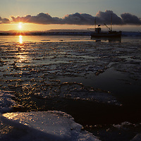 Europe, Norway, Fishing boat along arctic coast in early winter near town of Vadso