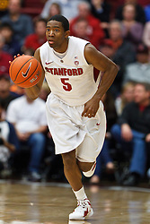 Dec 29, 2011; Stanford CA, USA;  Stanford Cardinal guard Chasson Randle (5) dribbles the ball up court against the UCLA Bruins during the first half at Maples Pavilion.  Stanford defeated UCLA 60-59. Mandatory Credit: Jason O. Watson-US PRESSWIRE