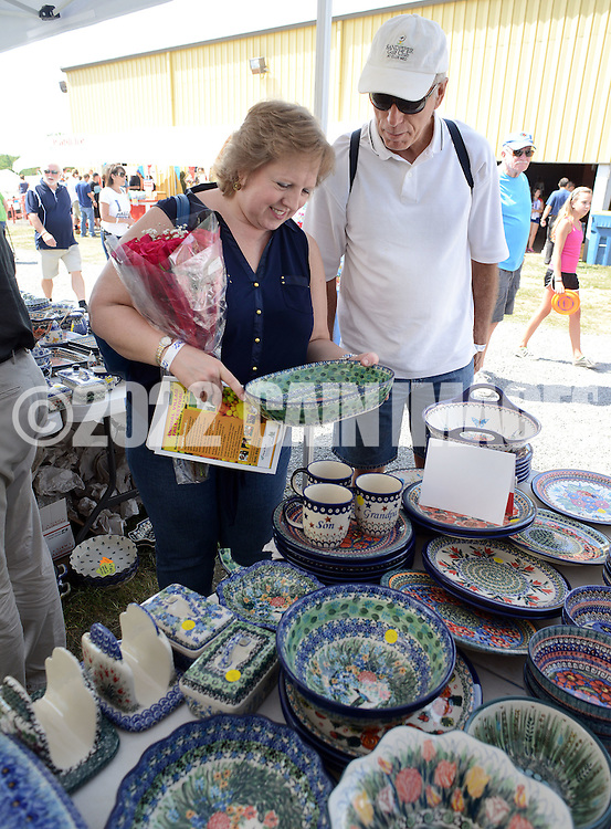 PSHRINE07P<br /> Debbie Rice (L) and Steve Rice of Florham {ark, New Jersey view polish pottery during the 50th annual Polish American family festival and country fair at the National Shrine of Our Lady of Czestochowa Sunday September 6, 2015 in Doylestown, Pennsylvania.  (William Thomas Cain/For The Inquirer)