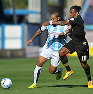 Sean Scannell of Huddersfield Town battles with Niel Danns of Bolton Wanderers during the Sky Bet Championship match at the John Smiths Stadium, Huddersfield<br /> Picture by Graham Crowther/Focus Images Ltd +44 7763 140036<br /> 19/09/2015