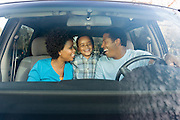 Family Sitting in Minivan