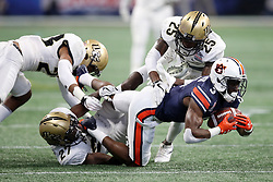 Auburn Tigers wide receiver Nate Craig-Myers (3) is tackled by a group of UCF Knights during the 2018 Chick-fil-A Peach Bowl NCAA football game on Monday, January 1, 2018 in Atlanta. (Jason Parkhurst / Abell Images for the Chick-fil-A Peach Bowl)