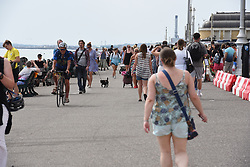 © Licensed to London News Pictures. 27/05/2020. Brighton, UK. Members of the public relax in the hot weather on Brighton seafront in East Sussex, during lockdown to prevent to spread of COVID-19.  Photo credit: Liz Pearce/LNP