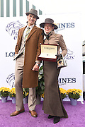 Brent Clancy, of Los Angeles, and Lisa Biederman, of Versailles, KY, pose for a photo after winning the Longines Prize of Elegance contest at the 2015 Breeders' Cup on Friday, Oct. 30, 2015 at Keeneland Racecourse in Lexington, KY.  Longines, the Swiss watch manufacturer known for its elegant timepieces, is the Official Watch and Timekeeper of the Breeders' Cup World Championships and the Triple Crown. (Photo by Diane Bondareff/Invsion for Longines/AP Images)