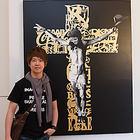 """VENICE, ITALY - JUNE 02:  Artist KEA  poses  in front of """"Salute to Fashion"""" a work  part of the Exhibition Future Pass on June 2, 2011 in Venice, Italy. The Venice Art Biennale will run from June 4 to November 27, 2011."""