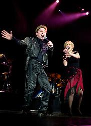 Pop Duo, Dollar on tour with<br /><br />Steve Starnge (Visage)<br />Claire Grogan (Altered Images)<br />The Belle Stars<br />Kim Wilde<br />The Human League<br />Play on the Here and Now  Christmas Party Tour at Sheffields Hallam FM Arena Friday 13th December 2002<br /><br />[#Beginning of Shooting Data Section]<br />Nikon D1 <br />2002/12/13 21:31:35.4<br />JPEG (8-bit) Fine<br />Image Size:  2000 x 1312<br />Color<br />Lens: 24mm f/2.8<br />Focal Length: 24mm<br />Exposure Mode: Manual<br />Metering Mode: Spot<br />1/200 sec - f/3.2<br />Exposure Comp.: 0 EV<br />Sensitivity: ISO 800<br />White Balance: Auto<br />AF Mode: AF-S<br />Tone Comp: Normal<br />Flash Sync Mode: Not Attached<br />Color Mode: <br />Hue Adjustment: <br />Sharpening: Normal<br />Noise Reduction: <br />Image Comment: <br />[#End of Shooting Data Section]