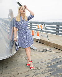 """Reese Witherspoon is currently busy filming the second season of HBO hit Big Little Lies. And the 42-year-old actress — who as well as starring in the show is also a producer — took the opportunity to use the pretty Monterey, California, backdrop to do a photoshoot to launch the summer campaign for her Draper James clothing line. Reese is seen in a variety of outfits from the collection while on location of the hugely popular twisted drama. Speaking about the shoot, Reese explained: """"It was fun to merge my worlds together for a day and I'm excited to give you a sneak peek into my life as an actor, producer and founder and creative director of Draper James."""" In several shots, Reese is seen posing by a Bambi Airstream trailer, which appear to be stacked full of shoes. The mother-of-two said that the beachfront is her favorite place to film in Monterey on account of the rich nature on offer and asked about her filming rituals she added: """"Before tough scenes, we have really fun dance parties in our trailers!It helps us not to take ourselves too seriously and brings some fun to set."""" Asked what is to come in season 2 of Big Little Lies, Reese played it coy but did hint: """"More Lies."""" The show returns in 2019 on HBO, with co-stars Nicole Kidman, Shailene Woodley, Zoe Kravitz and Oscar darling Meryl Streep is also joining the cast. 17 May 2018 Pictured: Reese Witherspoon poses in Draper James items for the summer 2018 collection while on location of her HBO show Big Little Lies in Monterey, California. Photo credit: Draper James/ MEGA TheMegaAgency.com +1 888 505 6342"""