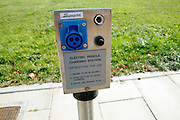 An electric vehicle charging station is available in the parking area of BedZED on Thursday, Sep. 6, 2007. BedZED or the Beddington Zero Energy Development, is an environmentally-friendly housing development near Wallington, England in the London Borough of Sutton. It was designed by the architect Bill Dunster who was looking for a more sustainable way of building housing in urban areas in partnership between the BioRegional Development Group and the Peabody Trust. There are 82 houses, 17 apartments and 1,405 square meters of work space were built between 2000. The project was shortlisted for the Stirling Prize in 2003. The project is designed to use only energy from renewable source generated on site. In addition to 777 square meters of solar panels, tree waste is used for heating and electricity. The houses face south to take advantage of solar gain, are triple glazed and have high thermal insulation while most rain water is collected and reused. Appliances are chosen to be water efficient and use recycled water wherever possible. Low impact building materials were selected from renewable or recycled sources and were all originating within a 35 mile radius of the site to minimize the energy required for transportation. Also, refuse collection facilities are designed to support recycling and the site encourage eco-friendly transport: electric and LPG cars have priority over petrol/diesel cars, and electricity is provided by parking spaces appositely built for charging electric cars.
