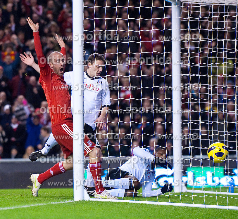 26.01.2011, Anfield, Liverpool, ENG, PL, Liverpool FC vs Fulham FC, im Bild Liverpool's Raul Meireles sees the ball cross the line for Liverpool's opening goal, an own goal from Fulham's John Pantsil during the Premiership match at Anfield, EXPA Pictures © 2011, PhotoCredit: EXPA/ Propaganda/ *** ATTENTION *** UK OUT!