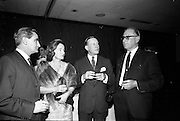 05/05/1965<br /> 05/05/1965<br /> 05 May 1965<br /> Ballsbridge Motors Ltd. Wholesale Division, reception at the Intercontinental Hotel Dublin. Chatting at the reception were (l-r): Mr. M.J. O'Keeffe, Director Ballsbridge Motors Ltd.; Mrs T.C. Andrews; Mr Allen Zane, Daimler - Benz, Stuttgard and Mr. Frank Wyse, Central Garage, Cork.