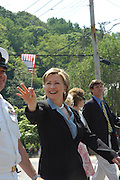 Chappaqua, NY, May 28: Hillary Clinton waves to the crowd during the Memorial Day parade in her hometown of Chappaqua, New York.  Hillary Rodham Clinton was a United States Senator at the time (2006) and was Grand Marshall of the parade.