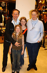 NICK & ARI ASHLEY with their children EDIE (front) and LILY (back) at a party to celebrate the opening of the new H&M Flagship Store at 17-21 Brompton Road, London SW3 on 23rd March 2005.<br />