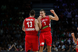 12.09.2014, City Arena, Madrid, ESP, FIBA WM, Frankreich vs Serbien, Halbfinale, im Bild Serbia´s Raduljica and Bogdanovic celebrate // during FIBA Basketball World Cup Spain 2014 semifinal match between France and Serbia at the City Arena in Madrid, Spain on 2014/09/12. EXPA Pictures © 2014, PhotoCredit: EXPA/ Alterphotos/ Victor Blanco<br /> <br /> *****ATTENTION - OUT of ESP, SUI*****