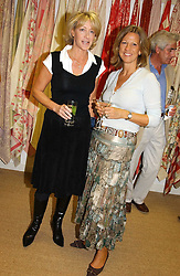 Left to right, LADY COSIMA SOMERSET and ANNE HALSEY at a party hosted by Kathryn Ireland held at her showroom at 65-69 Lots Road, London on 27th September 2005.<br />