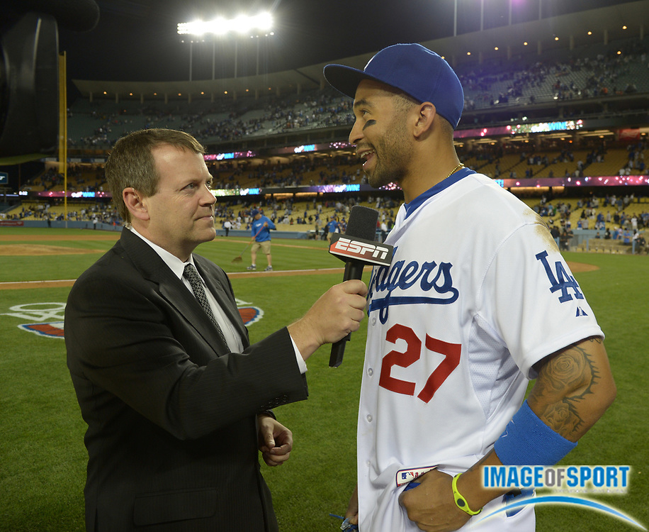 Apr 6, 2014; Los Angeles, CA, USA; ESPN broadcaster Buster Olney (left) interviews Los Angeles Dodgers center fielder Matt Kemp (27) after the game against the San Francisco Giants at Dodger Stadium. Kemp hit two home runs in the Dodgers 6-2 victory.