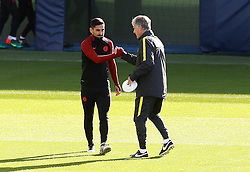 Manchester City assistant manager shakes hands with Ilkay Gundogan - Mandatory by-line: Matt McNulty/JMP - 18/10/2016 - FOOTBALL - Manchester City - Training session ahead of Champions League qualifier against FC Barcelona