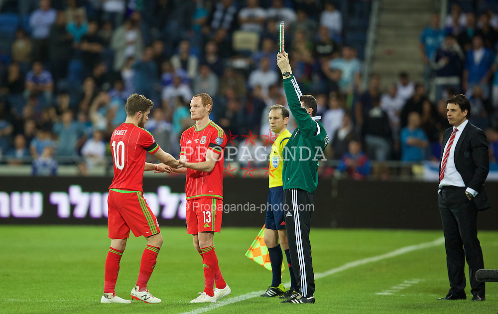HAIFA, ISRAEL - Saturday, March 28, 2015: Wales' substitute Shaun MacDonald replaces Aaron Ramsey against Israel during the UEFA Euro 2016 qualifying Group B match at the Sammy Ofer Stadium. (Pic by David Rawcliffe/Propaganda)