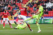 Brighton defender, full back, Liam Rosenior (23) clears from Charlton Athletic midfielder Callum Harriott (10) during the Sky Bet Championship match between Charlton Athletic and Brighton and Hove Albion at The Valley, London, England on 23 April 2016.