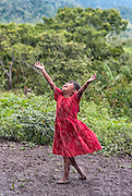 Gloria Aguilar dancing in the first rain of the rainy season in Bonete, Honduras.
