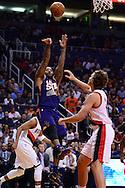 Nov 2, 2016; Phoenix, AZ, USA; Phoenix Suns forward P.J. Tucker (17) shoots the ball in front of Portland Trail Blazers forward Meyers Leonard (11) during the first half at Talking Stick Resort Arena. Mandatory Credit: Jennifer Stewart-USA TODAY Sports
