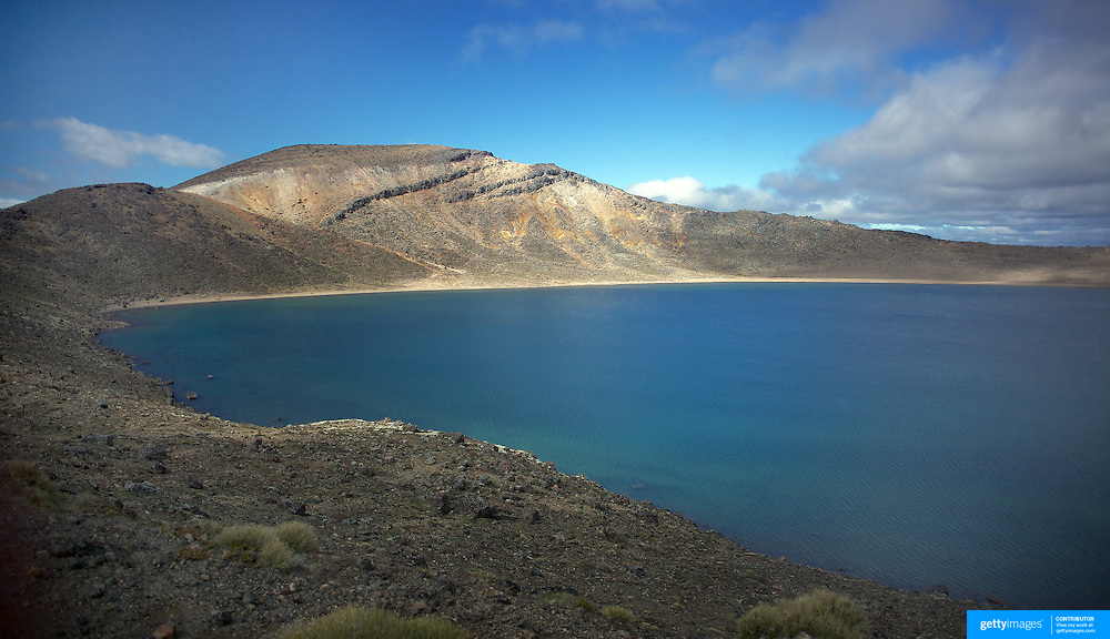 The Blue Lake on the Tangariro Alpine Crossing.  The Tongariro Alpine Crossing is a 7-8 hour hike traversing two active volcanoes within the Tongariro National Park, North Island, New Zealand.  It is considered to be the best one day hike in New Zealand and in the top 10 one day hikes in the world. Packed into the 19.4km hike is an array of diverse landscapes and vegetations. From tussock like alpine meadows, to rugged lava flows, desert like craters and emerald lakes.  The Tongariro Alpine  9th January 2011. Photo Tim Clayton..