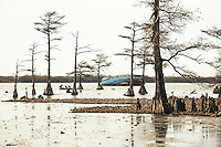 Overturned and abandoned fishing vessel rests permanently in lake in Venice, LA.  Copyright 2011 Reid McNally