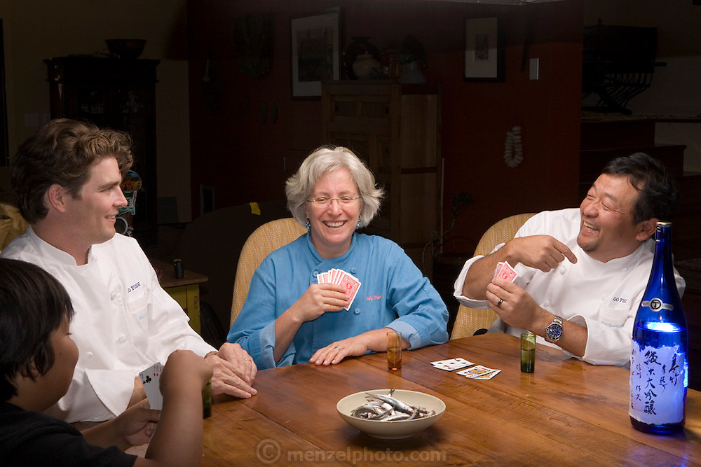 """Sean Knight plays """"Go Fish"""" and drinks saki with partners and fellow chefs Cindy Pawlcyn and Ken Tominaga at Cindy's St. Helena home in the Napa Valley, CA. They are about to open a new restaurant in St. Helena, called Go Fish. Also playing is Ken's 9 year old son."""