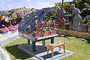 whimsical piano sculpture, colorful mosaics, curved bench, musical notes, The Giant's House, Josie Martin, Akaroa,  New Zealand