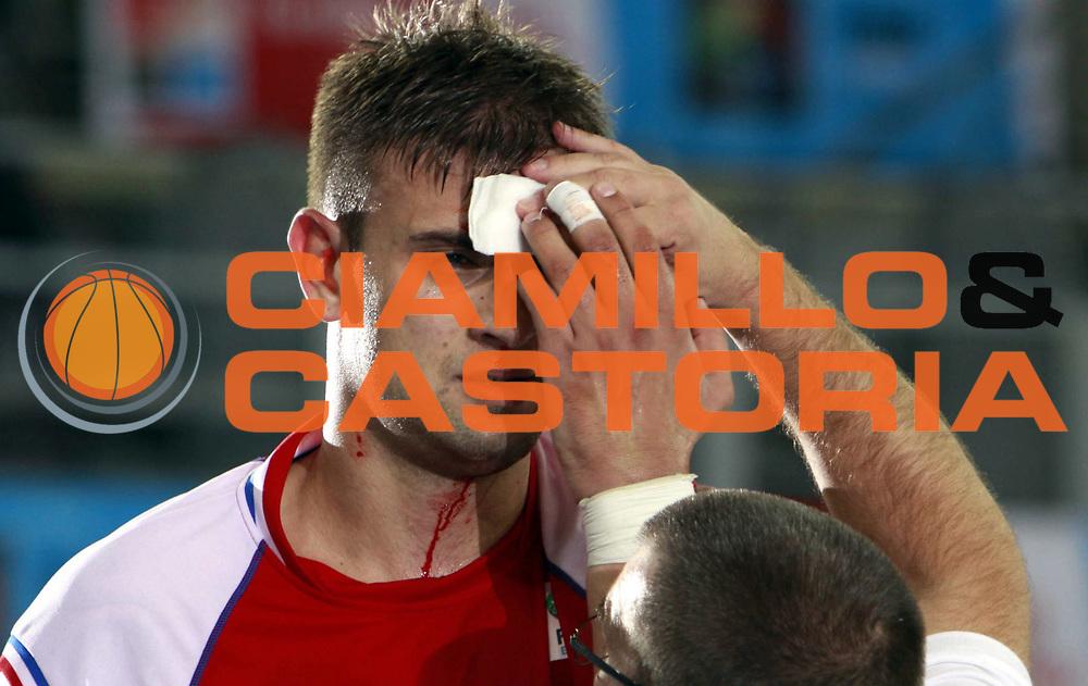DESCRIZIONE : Bydgoszcz Poland Polonia Eurobasket Men 2009 Qualifying Round Russia Croazia Croatia<br /> GIOCATORE : Mario Kasun<br /> SQUADRA : Croazia Croatia<br /> EVENTO : Eurobasket Men 2009<br /> GARA : Russia Croazia Croatia<br /> DATA : 11/09/2009 <br /> CATEGORIA : infortunio<br /> SPORT : Pallacanestro <br /> AUTORE : Agenzia Ciamillo-Castoria/H.Bellenger<br /> Galleria : Eurobasket Men 2009 <br /> Fotonotizia : Bydgoszcz Poland Polonia Eurobasket Men 2009 Qualifying Round Russia Croazia Croatia<br /> Predefinita :