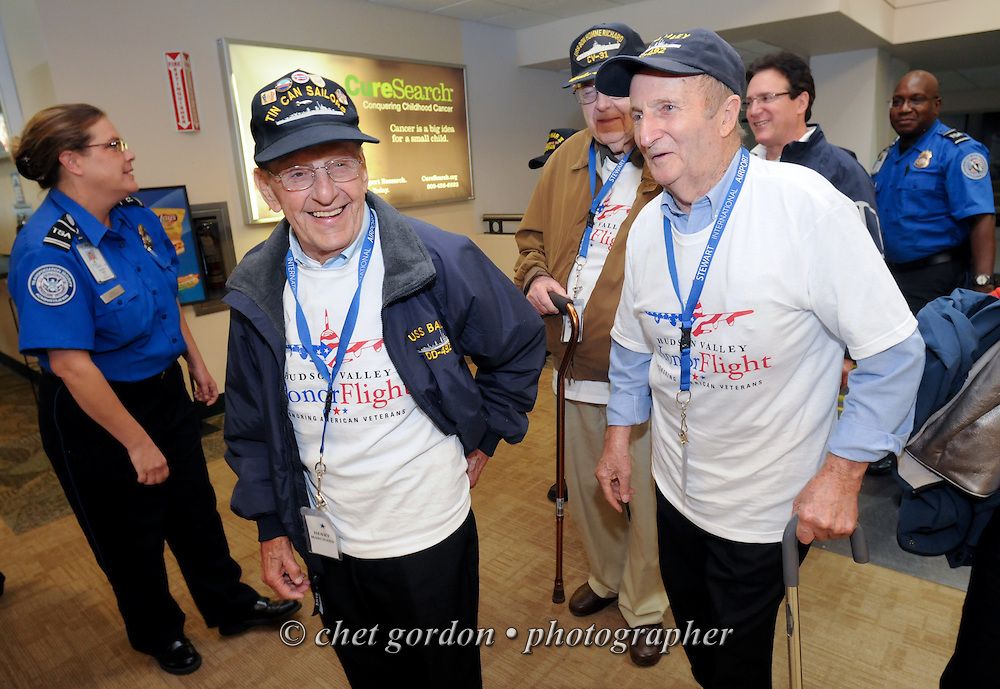 NEWBURGH, NY.  WWII Veterans and their escorts aboard the Hudson Valley Honor Flight during the departure ceremony at Stewart International Airport prior to their chartered flight to the World War II Memorial in Washington, DC on Saturday, September 21, 2013.  © www.chetgordon.com