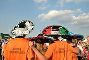 Three members of a Dutch team wear sombreros they received via a trade with a Mexican team at the closing cermonies of the International Children's Games in Windsor, Ontario.