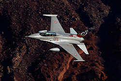 General Dynamics F-16B Fighting Falcon ET-210 of the Royal Danish Air Force, assigned to the US Air Force's 461st Flight Test Squadron, flies low level through theJedi Transition, Star Wars Canyon, California, Death Valley National Park, United States of America