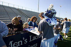 06 May 2007: Duke Blue Devils defenseman Casey Carroll (37) signs autographs after a 19-6 victory over the Air Force Falcons at Koskinen Stadium in Durham, NC.