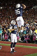 Penn State Nittany Lions tight end Mike Gesicki (88) looks on as Penn State Nittany Lions running back Saquon Barkley (26) leaps in the air as he celebrates after catching a 7 yard third quarter touchdown pass that gives the Lions a 49-35 lead during the 2017 NCAA Rose Bowl college football game against the USC Trojans, Monday, Jan. 2, 2017 in Pasadena, Calif. The Trojans won the game 52-49. (©Paul Anthony Spinelli)