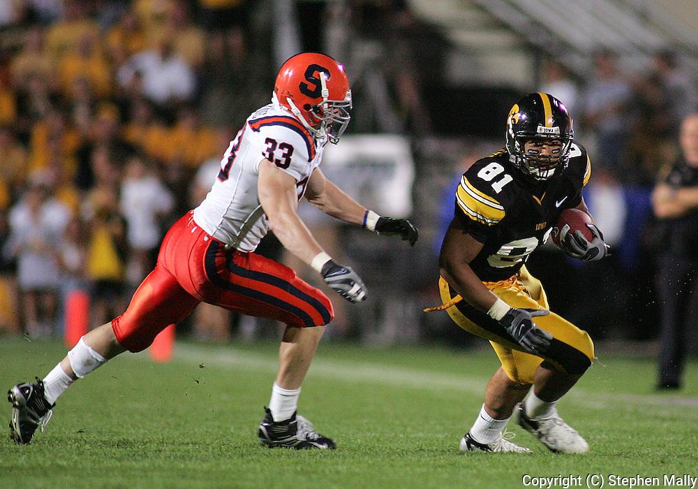 08 SEPTEMBER 2007: Iowa tight end Tony Moeaki (81) tries to avoid Syracuse linebacker Ben Maljovec (33) in Iowa's 35-0 win over Syracuse at Kinnick Stadium in Iowa City, Iowa on September 8, 2007.