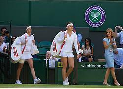 LONDON, ENGLAND - Thursday, July 3, 2014: Lucie Safarova (CZE) and Petra Kvitova (CZE) walk onto Centre Court before the all-Czech Ladies' Singles Semi-Final match on day ten of the Wimbledon Lawn Tennis Championships at the All England Lawn Tennis and Croquet Club. (Pic by David Rawcliffe/Propaganda)