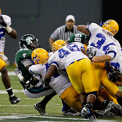 Sep 26, 2009; New Orleans, LA, USA;  Tulane Green Wave running back Andre Anderson (32) is tackled by a host of McNesse State Cowboys defenders at the Louisiana Superdome. Tulane defeated McNeese State 42-32. Mandatory Credit: Derick E. Hingle-US PRESSWIRE
