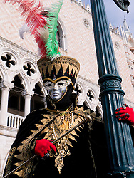 Masked man in Carnival or Carnevale in Venice Italy