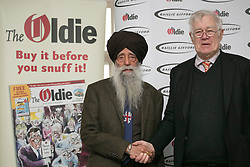 © licensed to London News Pictures. London, UK 12/02/2013. Fauja Singh (left) and Richard Ingrams attend The Oldie of the Year Awards at Simpsons in the Strand on February 12, 2013 in London. Photo credit: Tolga Akmen/LNP