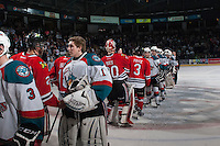 KELOWNA, CANADA - APRIL 25: The # of the Kelowna Rockets and the Portland Winterhawks shake hands on April 25, 2014 during Game 5 of the third round of WHL Playoffs at Prospera Place in Kelowna, British Columbia, Canada. The Portland Winterhawks won 7 - 3 and took the Western Conference Championship for the fourth year in a row earning them a place in the WHL final.  (Photo by Marissa Baecker/Getty Images)  *** Local Caption ***