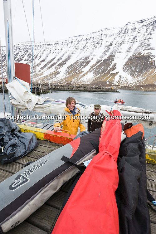 R&uacute;nar Karlsson and Styrmir Steingr&iacute;msson loading ski gear on the Aurora.<br /> <br /> Images from an ski touring adventure to J&ouml;kulfir&eth;ir, a series of fjords in west Iceland, with Bergmenn Mountain Guides and Borea Adventures. The tour takes skiers from fjord to fjord with the sail boat Aurora as a overnight base.
