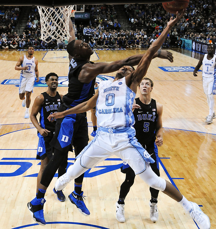 North Carolina guard Nate Britt (0) is fouled by Duke forward Harry Giles (1) during the semifinals of the 2017 New York Life ACC Tournament at the Barclays Center in Brooklyn, N.Y., Friday, March 10, 2017. (Photo by David Welker, theACC.com)