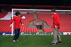 "LIVERPOOL, ENGLAND - 1996: John Power (R) and Peter ""Cammy"" Cammell of band Cast on the pitch at Anfield, home of Liverpool FC. (Pic by David Rawcliffe/Propaganda)"