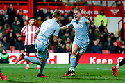 Leeds United defender Liam Cooper (6) scores a goal and celebrates with Leeds United midfielder Kalvin Phillips (23) to make the score 1-1  during the EFL Sky Bet Championship match between Brentford and Leeds United at Griffin Park, London, England on 11 February 2020.