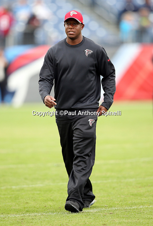 Atlanta Falcons assistant head coach / defensive passing game coordinator Raheem Morris watches pregame warmups before the 2015 week 7 regular season NFL football game against the Tennessee Titans on Sunday, Oct. 25, 2015 in Nashville, Tenn. The Falcons won the game 10-7. (©Paul Anthony Spinelli)