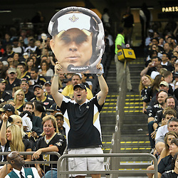 August 17, 2012; New Orleans, LA, USA; New Orleans Saints fan Michael Super holds up a sign of suspended head coach Sean Payton during the second half of a preseason game against the Jacksonville Jaguars at the Mercedes-Benz Superdome. The Jaguars defeated the Saints 27-24.  Mandatory Credit: Derick E. Hingle-US PRESSWIRE