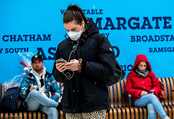© Licensed to London News Pictures. 05/03/2020. London, UK. A young women heads to work wearing a mask in Victoria Station as the Government announces plans to combat the coronavirus disease crisis. Photo credit: Alex Lentati/LNP