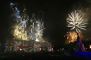 Fireworks cascading from the roof of Buckingham Palace during a display at the end of a rock concert held in the palace grounds to celebrate Queen Elizabeth II's Golden Jubilee. Celebrations took place across the United Kingdom with the centrepiece a parade and fireworks at Buckingham Palace, the Queen's London residency. Queen Elizabeth ascended to the British throne in 1952 upon the death of her father, King George VI.